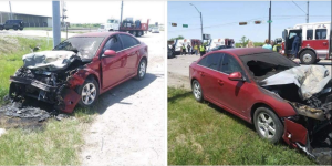 A red car on the side of the road after catching fire in Dallas